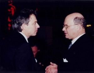 With British Prime Minister Tony Blair.